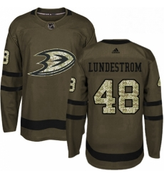 Mens Adidas Anaheim Ducks 48 Isac Lundestrom Authentic Green Salute to Service NHL Jersey